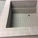 社員寮の浴槽の防水工事(FRP防水・左官工事・タイル貼り)|神奈川県高座郡寒川町の某工場